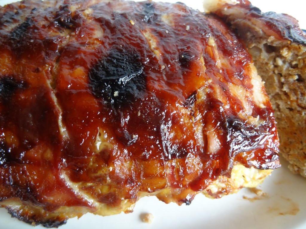 Crispy Bacon Wrapped Meatloaf Topped with Barbeque Sauce